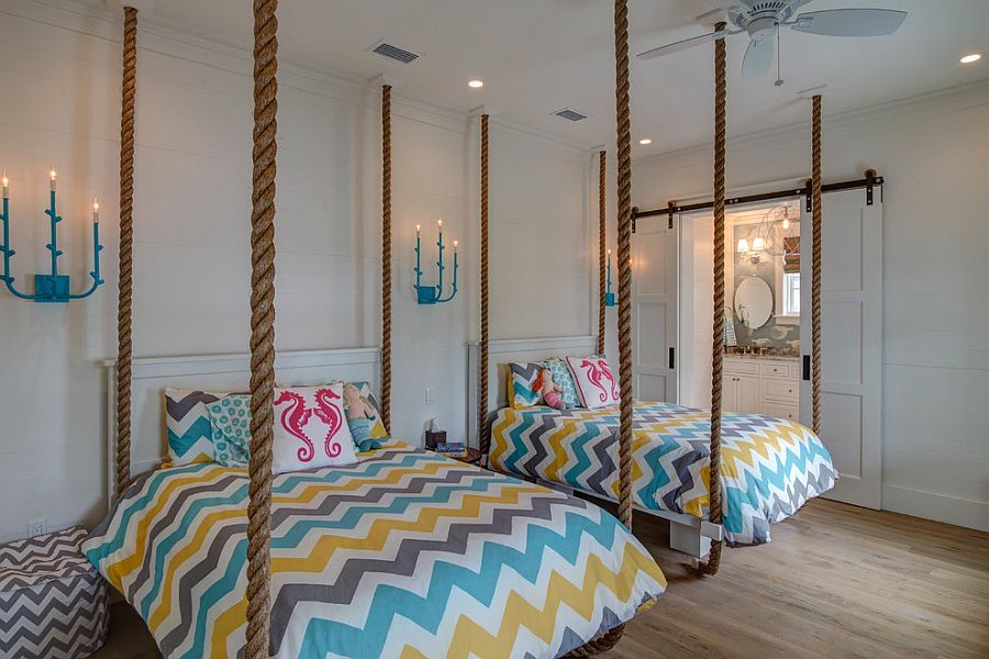 Принт шеврон. Симметричный разноцветный рисунок на двух детских кроватях от 30A Interiors