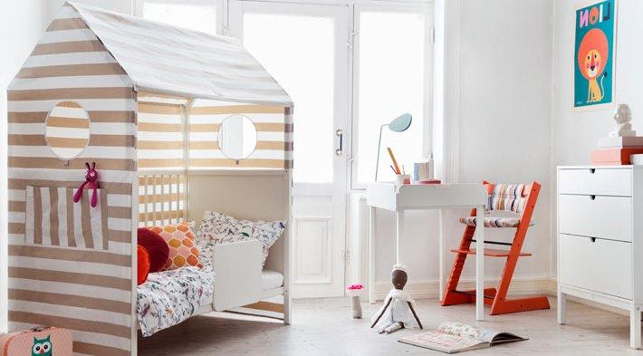 Кровать домик для ребёнкаоформлен тканью